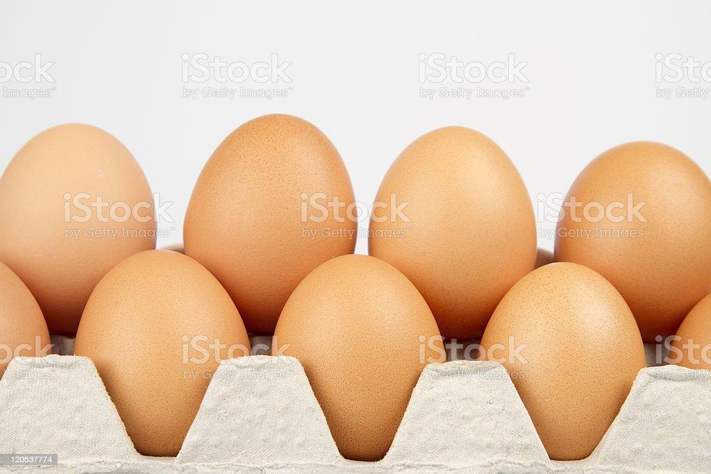Brown eggs in box stock photo