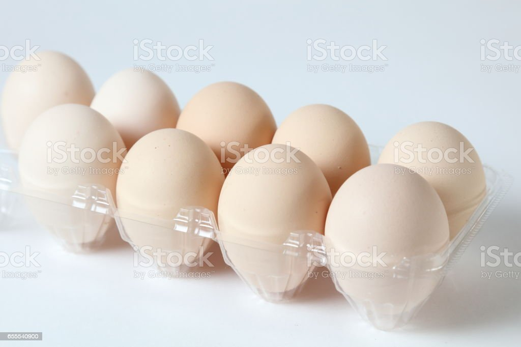Brown eggs in the white package stock photo