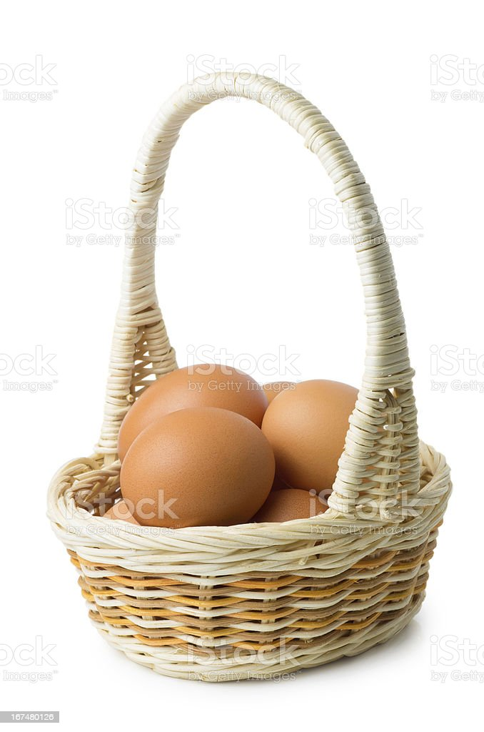 Brown eggs in wicker basket with long handle royalty-free stock photo