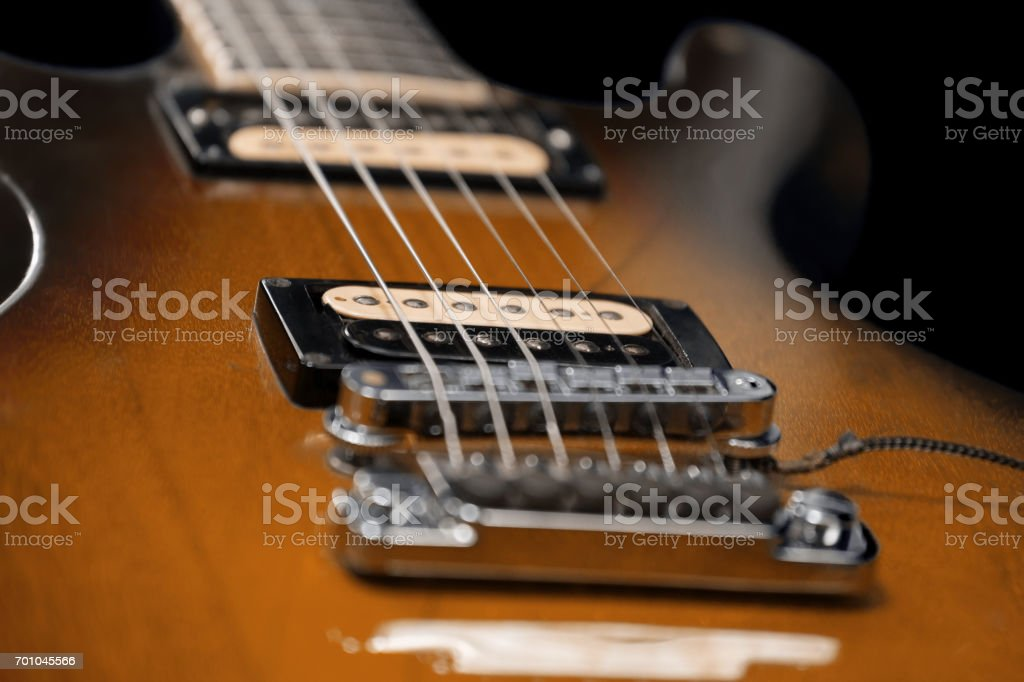 Brown electric guitar detail. Old and worn stock photo