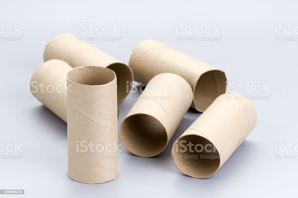 Brown empty toilet tissue paper rolls stock photo