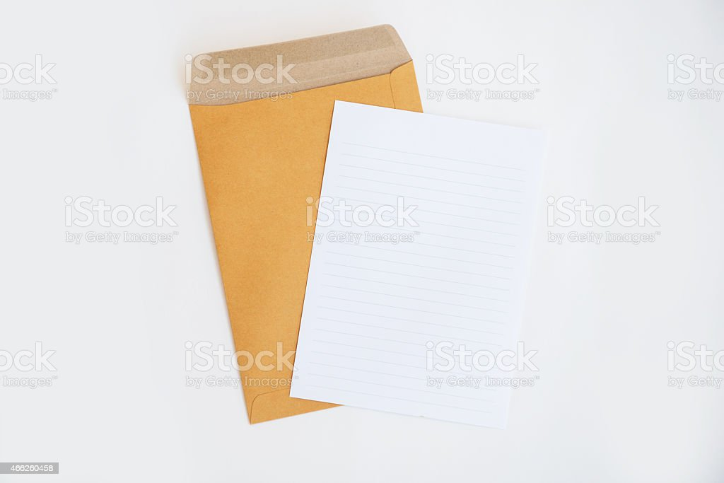brown envelope and paper note isolate on white background stock photo