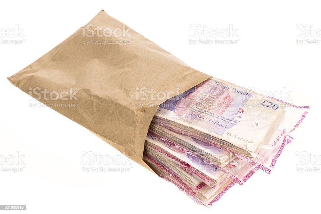 Brown envelope full of banknotes stock photo