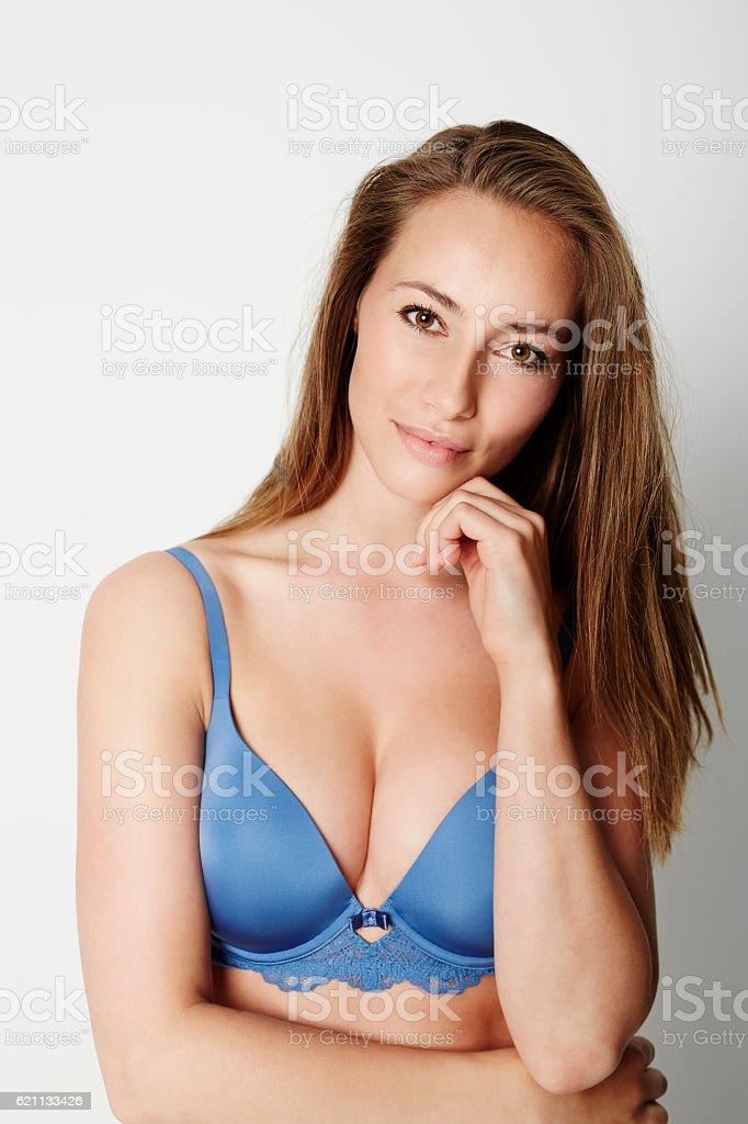 Brown eyed babe in blue bra, portrait stock photo