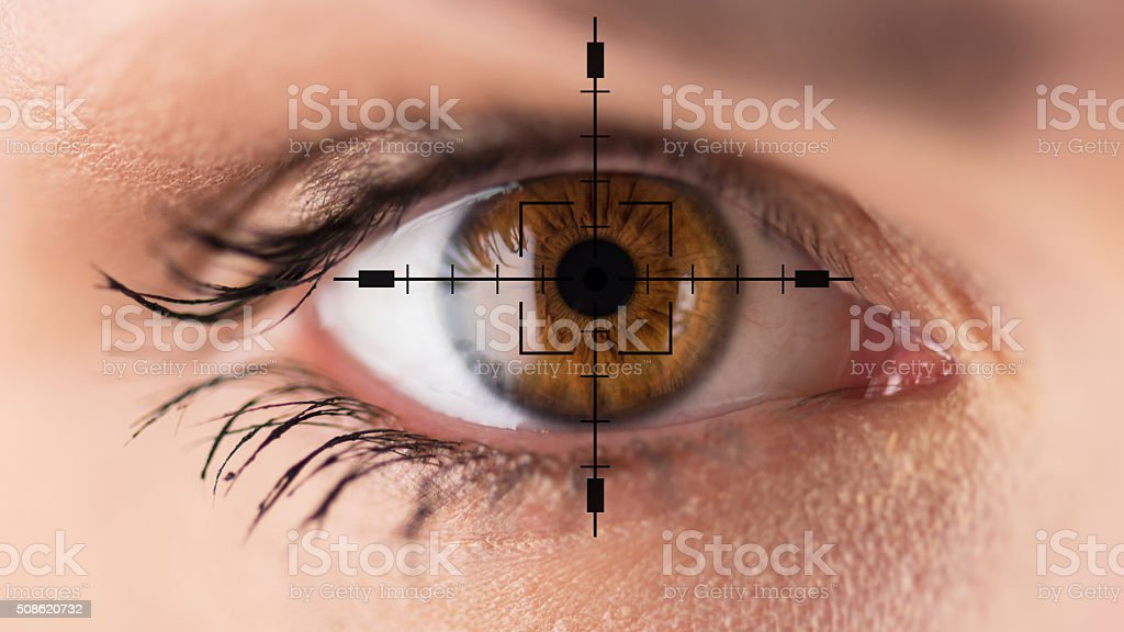 Brown eyes - eyesight test stock photo