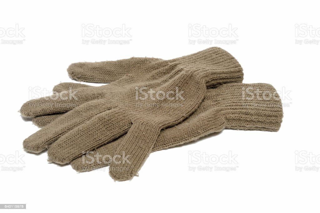 brown fabric glove on bright background. stock photo