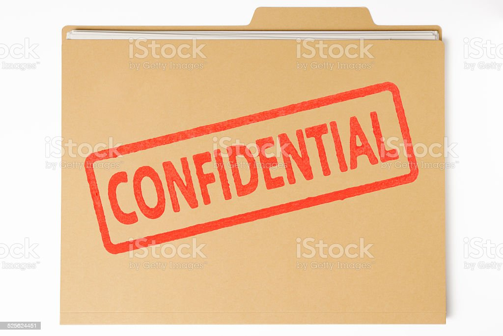 Brown file folder and document with CONFIDENTIAL red rubber stamp stock photo