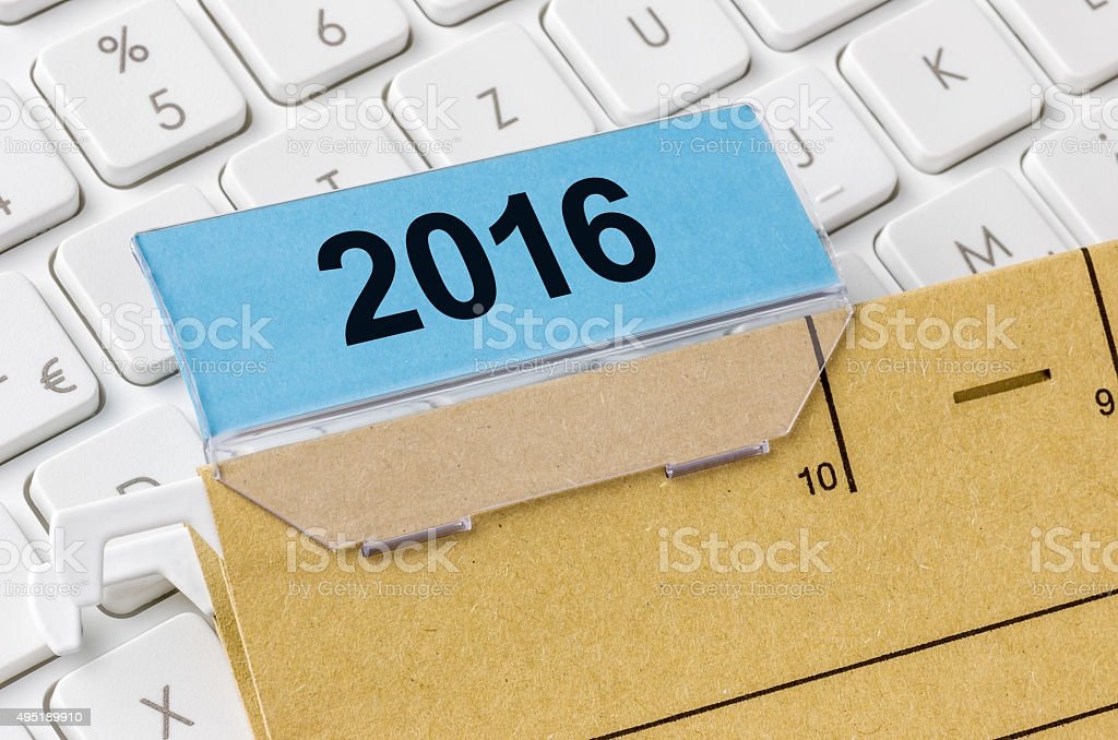 Brown file folder labeled with 2016 stock photo