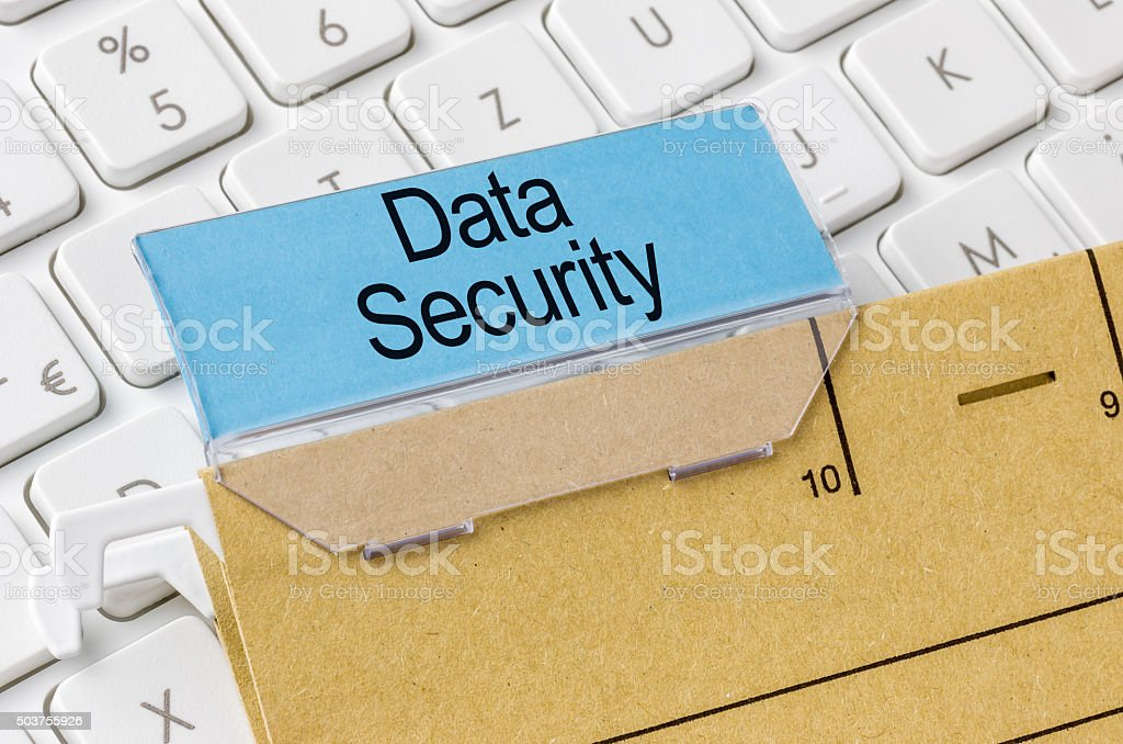 Brown file folder labeled with Data Security stock photo