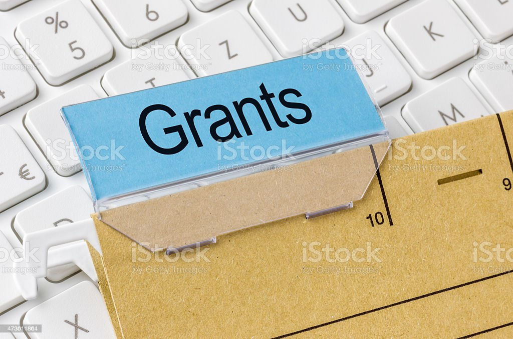 Brown file folder labeled with Grants stock photo