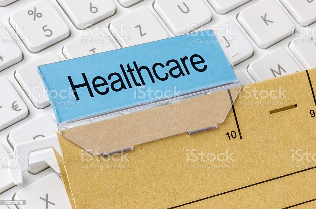 Brown file folder labeled with Healthcare stock photo