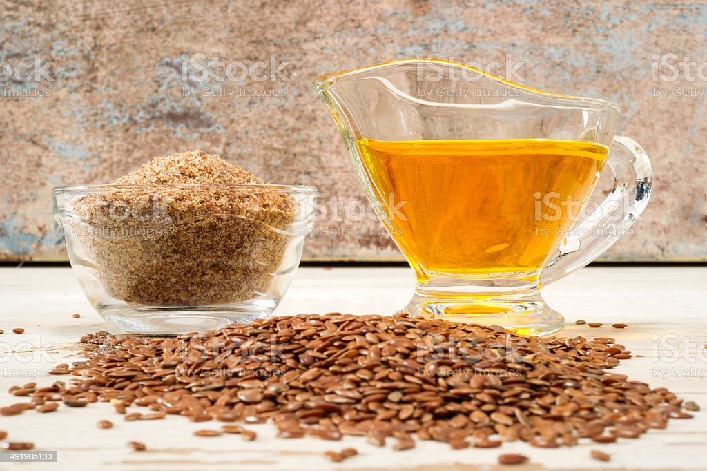 brown flax seed and linseed oil, selective focus stock photo