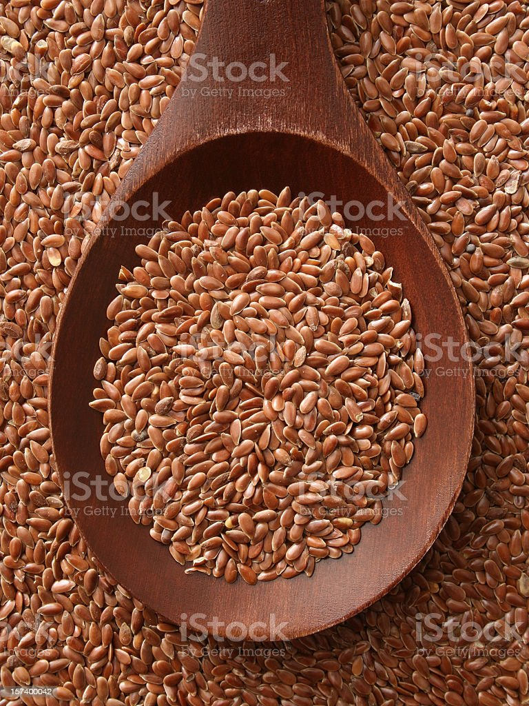 Brown flax seeds stock photo
