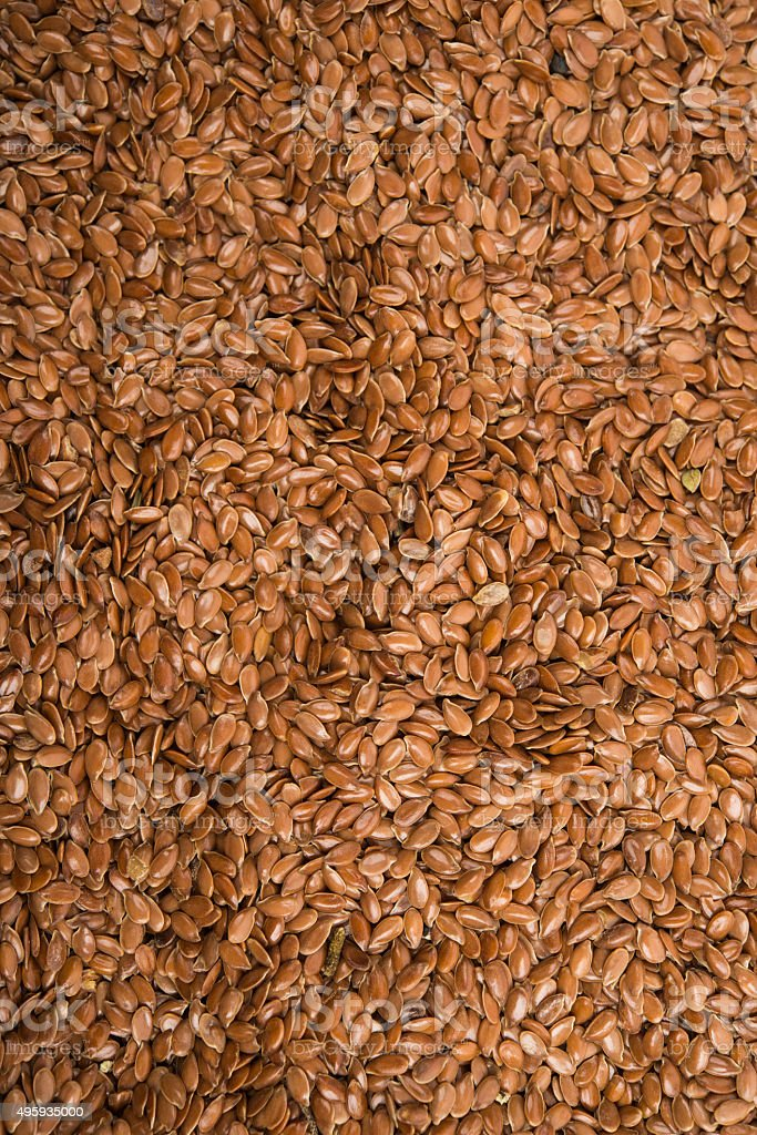 Brown flax seeds stock photo
