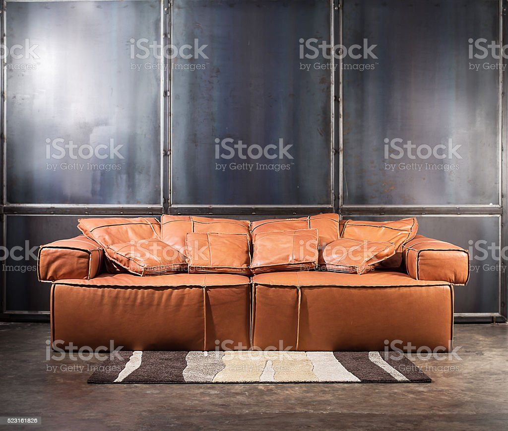 Brown furniture and concrete wall with spot lighting. stock photo