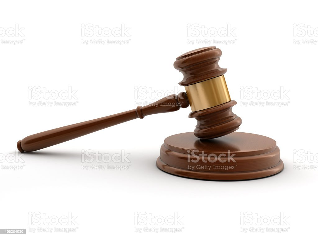 Brown gavel and sound block against a white background stock photo