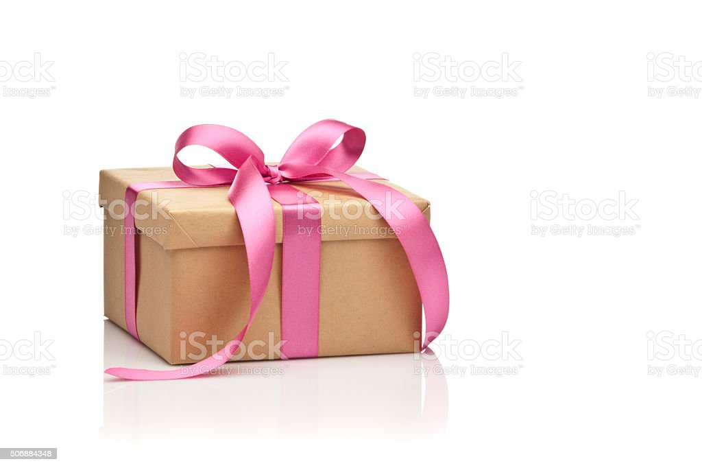Brown gift box tied up with bow isolated on white stock photo
