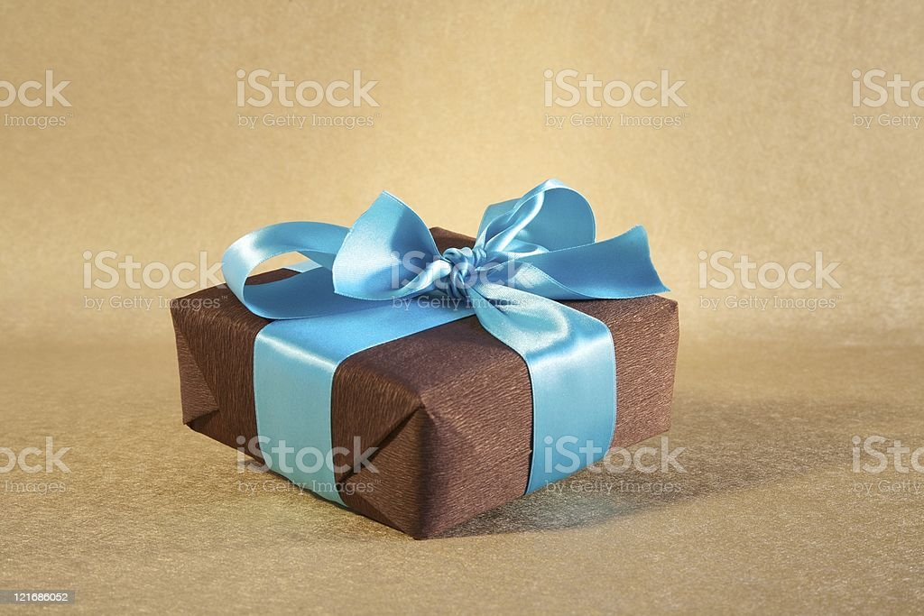 brown gift box with cyan bow royalty-free stock photo