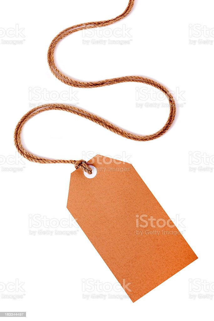 Brown gift tag or label with curly string. royalty-free stock photo