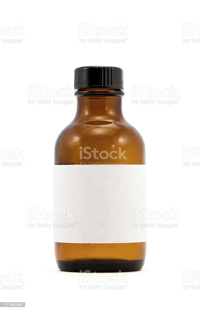 Brown glass medicine bottle with blank white label stock photo