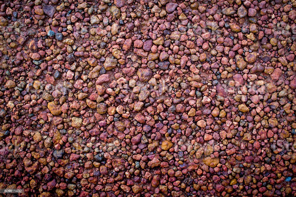 brown gravel texture background vignette added stock photo