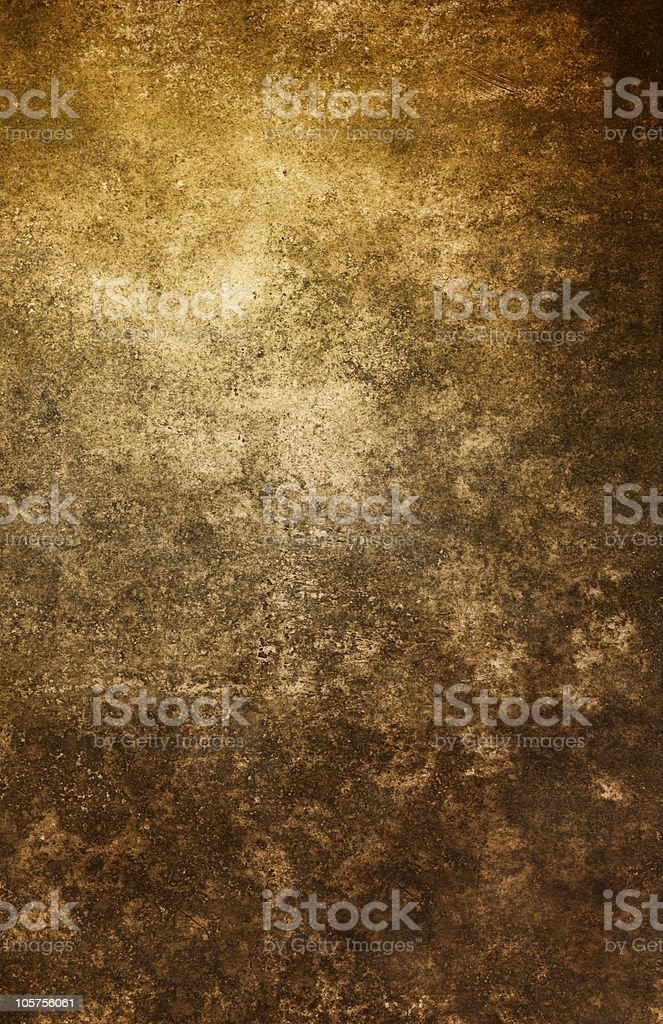 A brown grunge background with lighter spots royalty-free stock photo