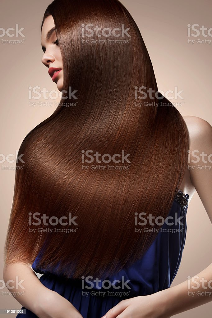 Brown Hair. Portrait of Beautiful Woman with Long Hair. stock photo