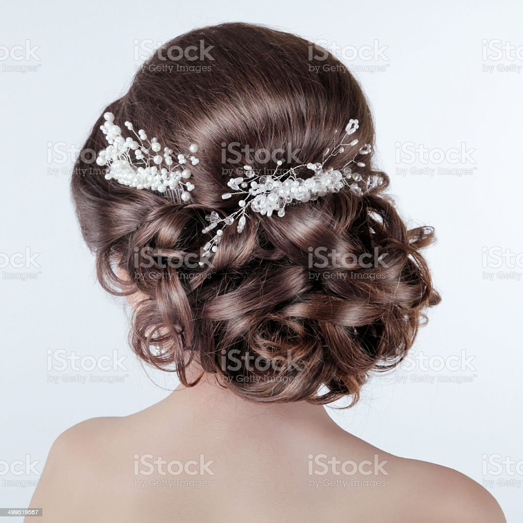 Brown hair styling. Brunette girl with curly hairstyle stock photo
