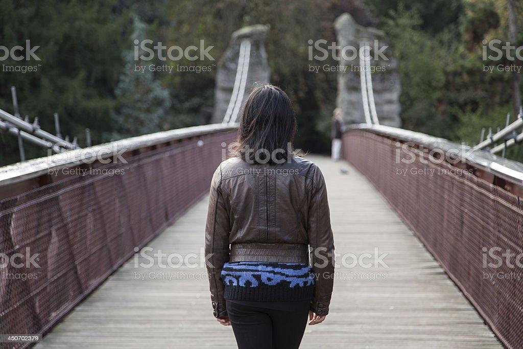 Brown hair woman on a bridge stock photo