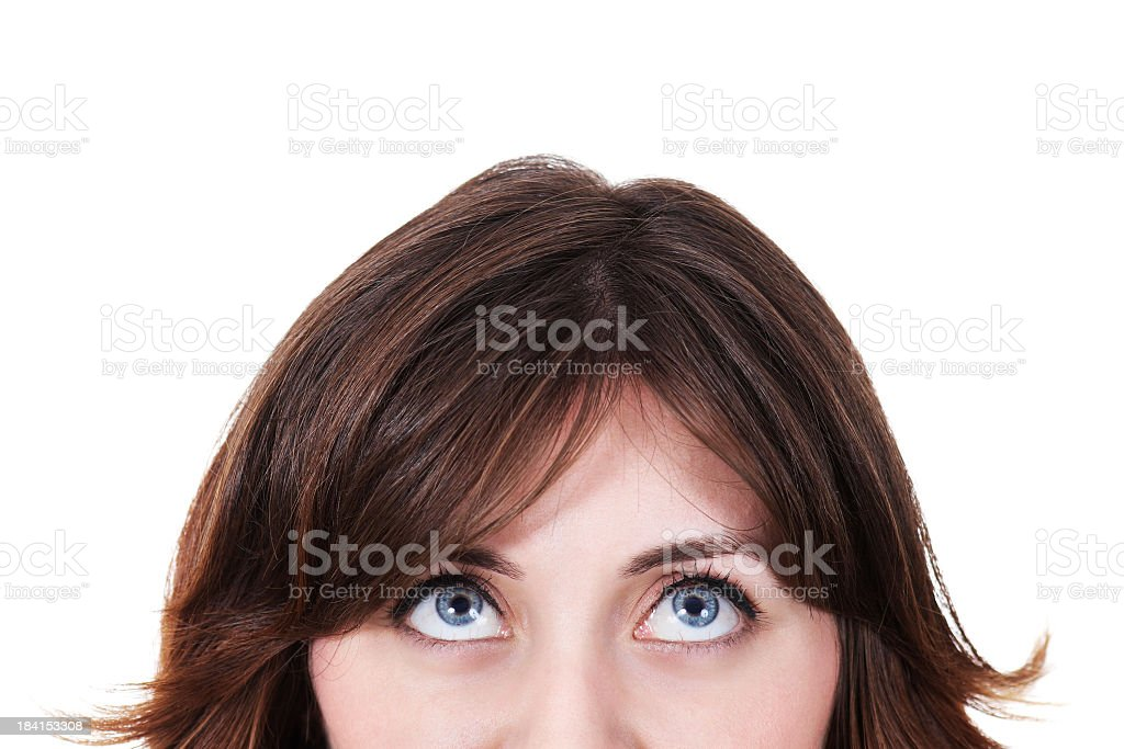 A brown haired woman looking up on a white background stock photo