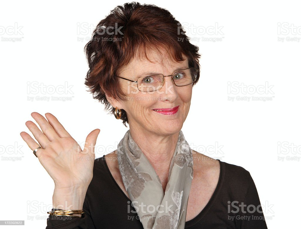 A brown haired woman with glasses waving with her right hand stock photo