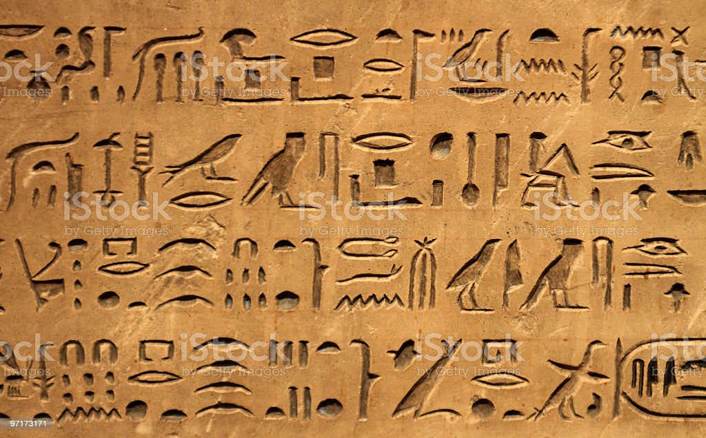 A brown hieroglyphic background stock photo