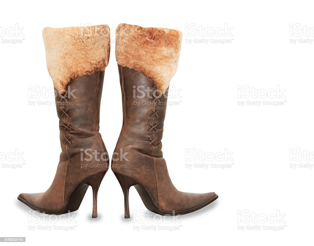 Brown high heels suede woman boots isolated over white stock photo