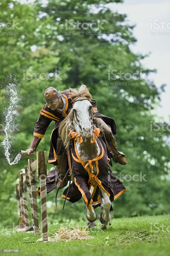 Brown knight riding a horse stock photo