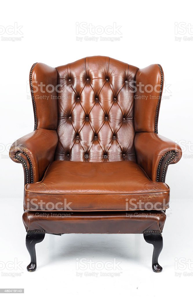Brown leather armchair isolated on white stock photo