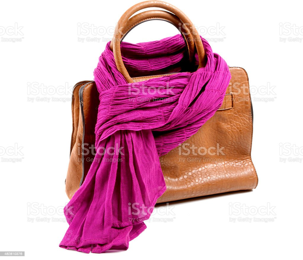Brown leather bag and violet scarf isolated stock photo