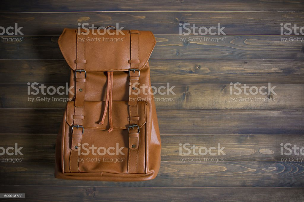 Brown leather bag on wooden table stock photo