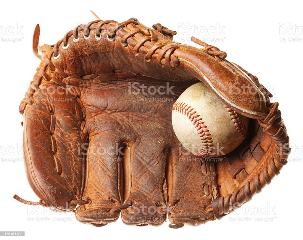 Brown leather baseball glove with a white ball stock photo