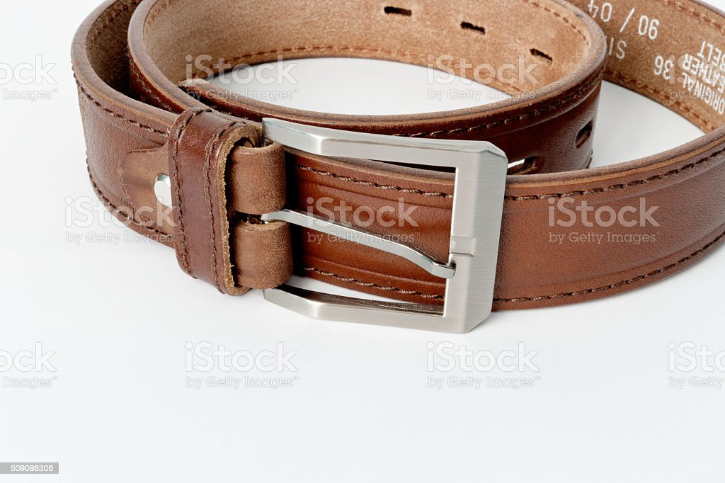 Brown leather belt isolated on white stock photo