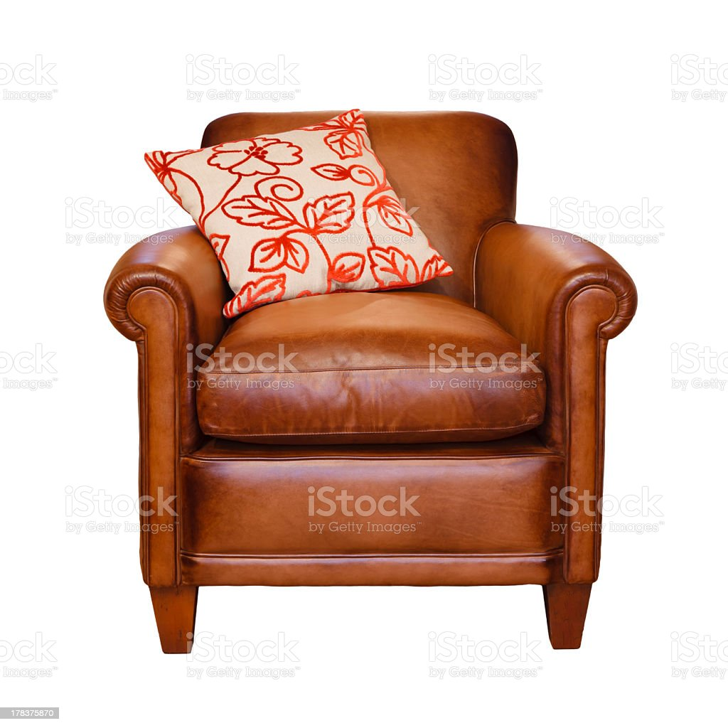 Brown leather chair with pillow against a white background stock photo