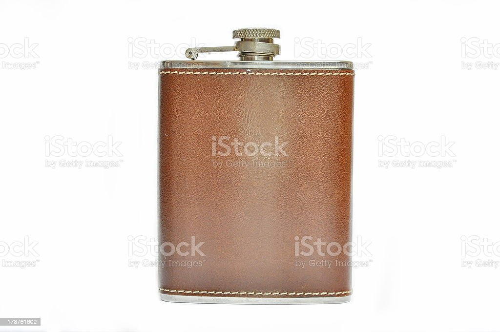Brown leather covered silver hip flask on a white background stock photo