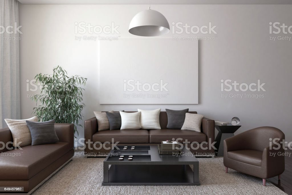 Brown leather furniture with cushions and blank canvas stock photo