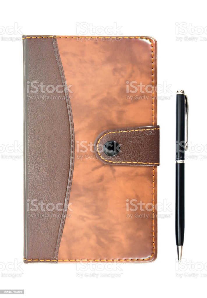 Brown leather notebook with pen isolated on white background. stock photo