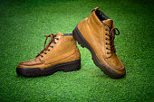 brown leather retro shoes on green grass background