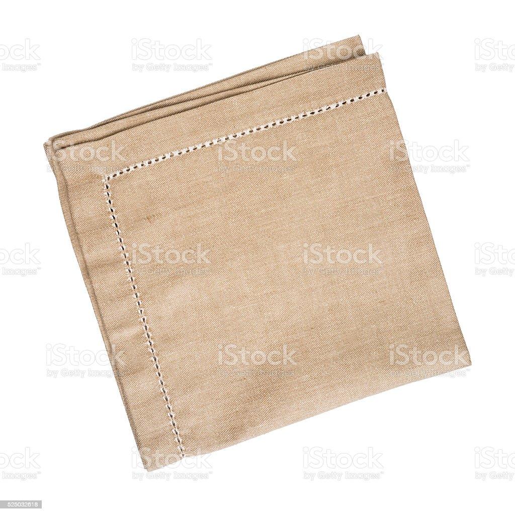 Brown linen napkin isolated on white background stock photo