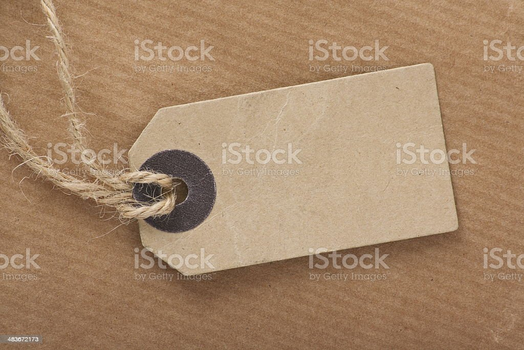 Brown Luggage Tag on Parcel Paper stock photo