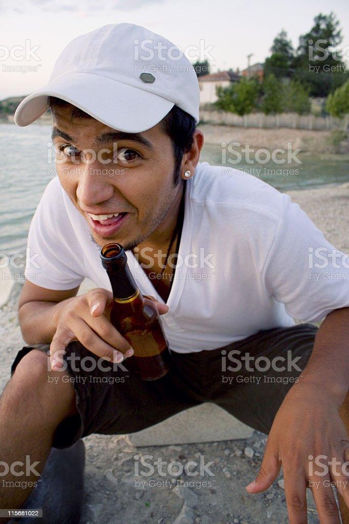 brown man drinking beer royalty-free stock photo