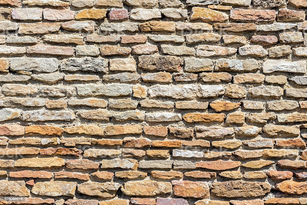 Brown masonry rock wall stock photo