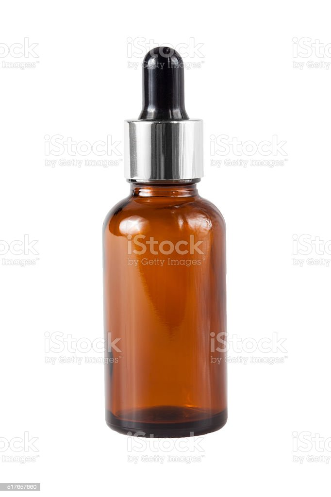 Brown medicine glass bottle with dropper isolated over white stock photo
