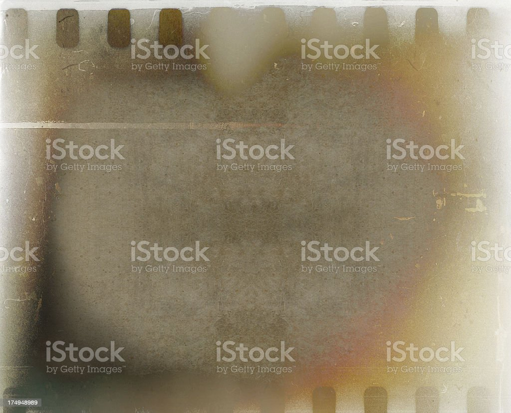 brown mottled background with film strip stock photo